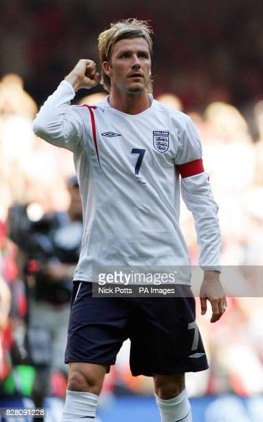 England captain David Beckham salutes the fans at the final whistle after defeating Wales 10 in the World Cup qualifier at the Millennium Stadium...