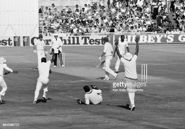 England captain David Gower is caught behind for 4 runs by West Indies wicketkeeper Jeffrey Dujon off the bowling of Eldine Baptiste during the 4th...