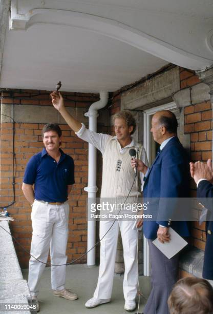 England captain David Gower shows off a replica Ashes urn to the crowd before it's presented to Australia's captain Allan Border during an interview...