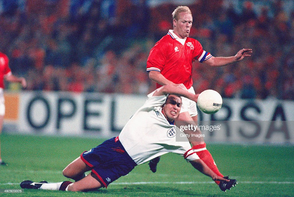 England captain David Platt (l) is fouled by Holland captain Ronald Koeman and in a controversial decision, no penalty is given, during the World Cup Qualifying match between Holland and England at the De Kuip Stadium on October 13, 1993 in Rotterdam, Netherlands.