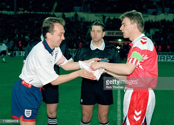 England captain David Platt meets Lars Olsen of Denmark watched by the match referee Jacobus Uilenberg prior to the friendly International at Wembley...