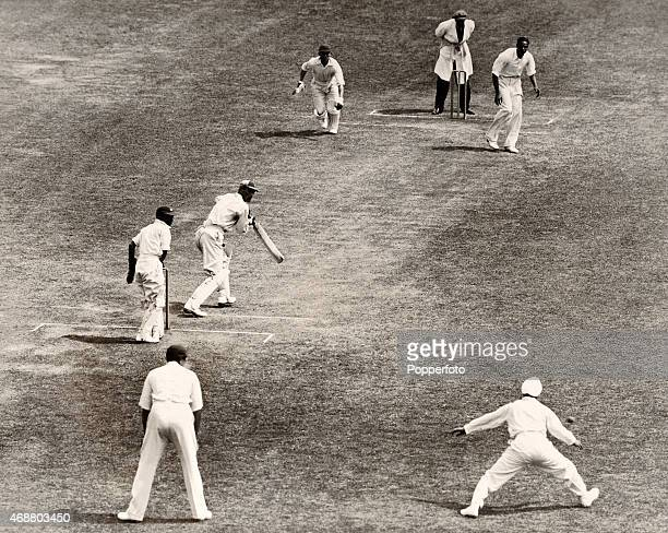 England captain Douglas Jardine steers a ball from All India bowler Amir Singh past second slip during the inaugural 1st Test match between England...