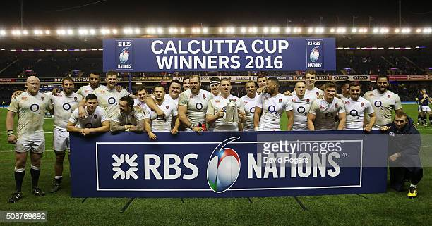 England captain Dylan Hartley and his team pose with the Calcutta Cup following their victory during the RBS Six Nations match between Scotland and...