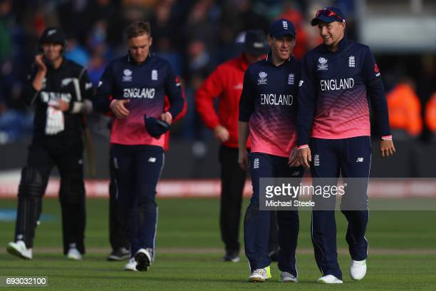 England captain Eoin Morgan alongside Joe Root after clinching a 87 run victory and a place in the semifinal during the ICC Champions Trophy match...