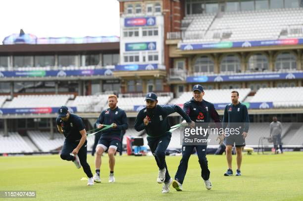 England captain Eoin Morgan and Adil Rashid take part in a training drill during England nets ahead of the opening match of the ICC Cricket World Cup...