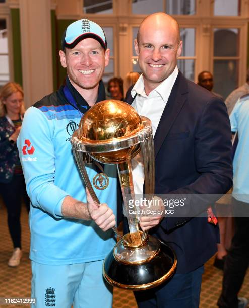 England captain Eoin Morgan and Andrew Strauss celebrate with the trophy after winning the Final of the ICC Cricket World Cup 2019 between New...