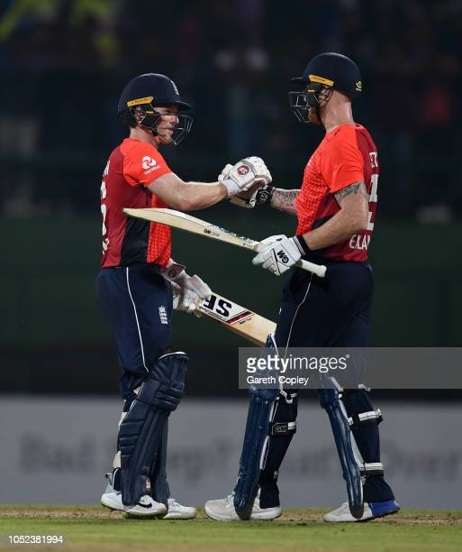 England captain Eoin Morgan and Ben Stokes celebrate winning the 3rd One Day International match between Sri Lanka and England at Pallekele Cricket...