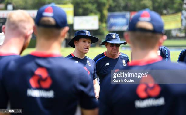 England captain Eoin Morgan and coach Trevor Bayliss speak to their team ahead of a nets session at P Sara Oval on October 3 2018 in Colombo