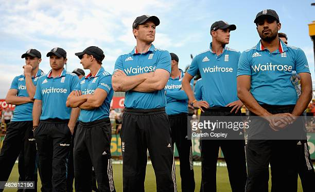 England captain Eoin Morgan and his team watch the presentations after losing the final match of the Carlton Mid One Day International series between...