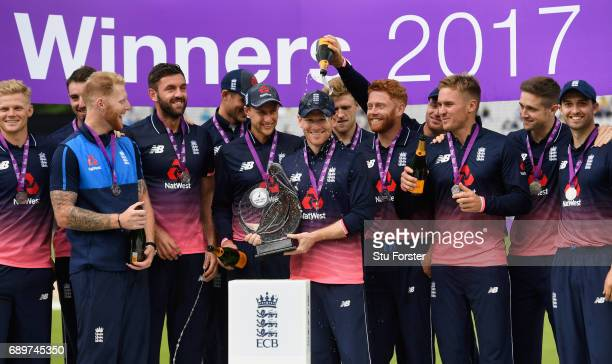 England captain Eoin Morgan and his team with the series trophy after the 3rd Royal London Cup match between England and South Africa at Lord's...