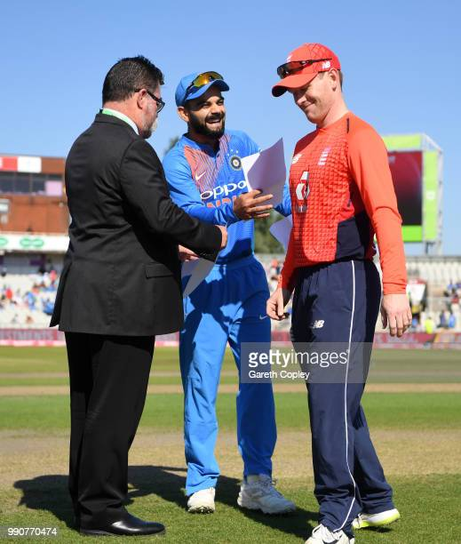 England captain Eoin Morgan and India captain Virat Kohli exchange teamsheets ahead of the 1st Vitality International T20 match between England and...