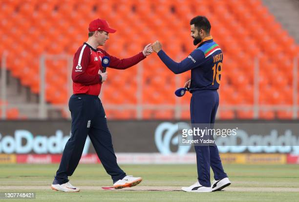 England captain Eoin Morgan and India captain Virat Kohli punch fists after the toss during the 4th T20 International between India and England at...