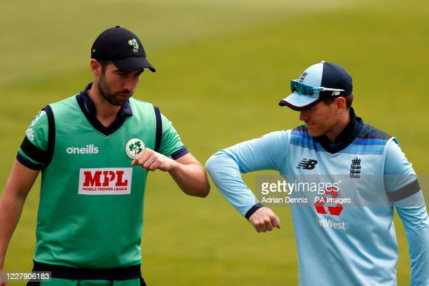 England captain Eoin Morgan and Ireland captain Andrew Balbirnie touch elbows after the toss ahead of the third One Day International match at the...