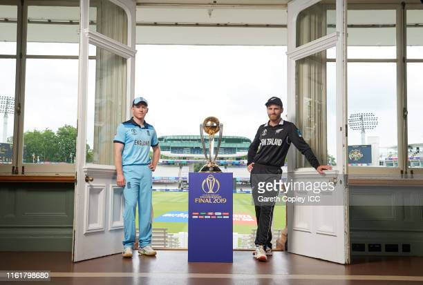 England captain Eoin Morgan and New Zealand captain Kane Williamson pose with the trophy prior to the final of the ICC Cricket World Cup 2019 between...