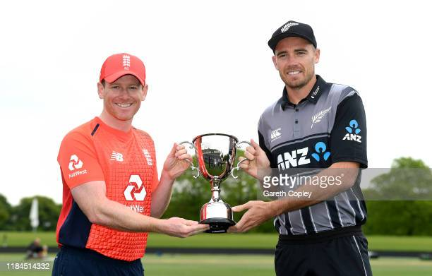 England captain Eoin Morgan and New Zealand captain Tim Southee pose with the Twenty20 International series trophy during a photocall at Hagley Park...