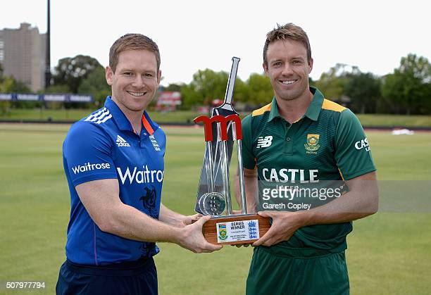 England captain Eoin Morgan and South Africa captain AB de Villiers hold the series trophy ahead of tomorrow's opening game at Mangaung Oval on...