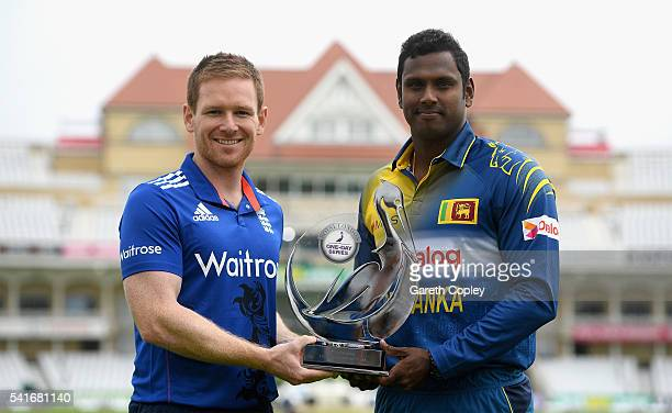 England captain Eoin Morgan and Sri Lanka captain Angelo Mathews hold the Royal London ODI series trophy at Trent Bridge on June 20 2016 in...