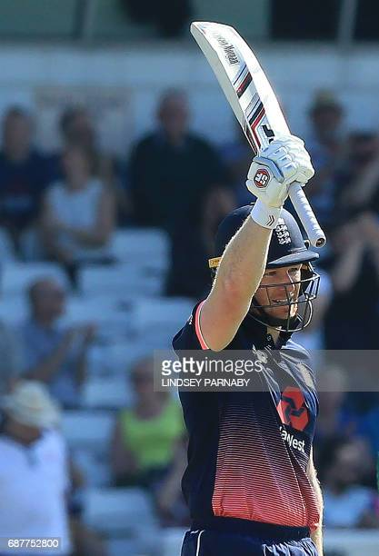 England captain Eoin Morgan celebrates his half century during the first OneDay International between England and South Africa at Headingley in Leeds...