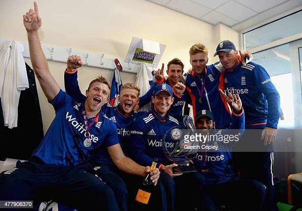 England captain Eoin Morgan celebrates in the dressing room with teammates David Willey, Sam Billings, James Taylor, Jason Roy, Adil Rashid and Jos...