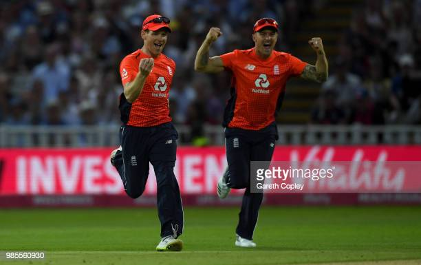 England captain Eoin Morgan celebrates with Jason Roy after winning the Vitality International T20 between England and Australia at Edgbaston on June...