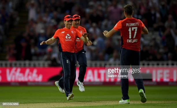 England captain Eoin Morgan celebrates with Jason Roy and Liam Plunkett after winning the Vitality International T20 between England and Australia at...
