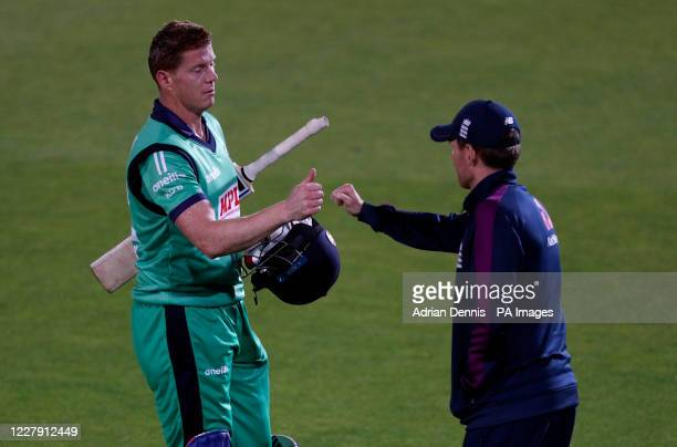 England captain Eoin Morgan congratulates Ireland's Kevin O'Brien after he secures runs to win the third One Day International match at the Ageas...