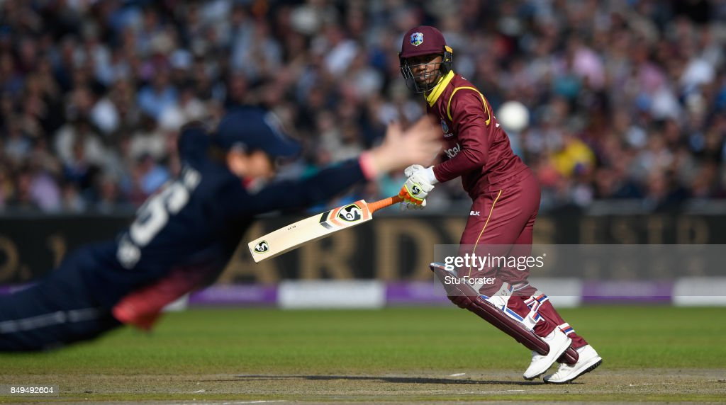 England captain Eoin Morgan dives in vain to stop a shot from West Indies batsman Evin Lewis during the 1st Royal London One Day International match between England and West Indies at Old Trafford on September 19, 2017 in Manchester, England.