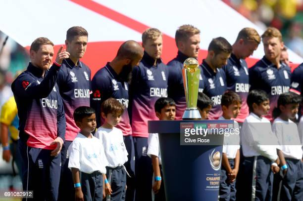 England captain Eoin Morgan gestures during the pre match line up prior to the ICC Champions trophy cricket match between England and Bangladesh at...