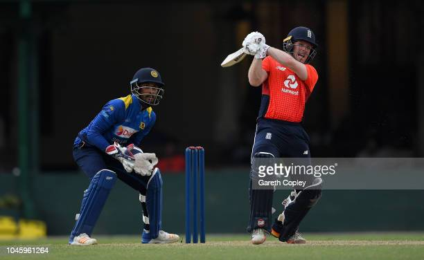 England captain Eoin Morgan hits out for six runs during the tour match between Sri Lanka Cricket Board XI and England at P Sara Oval on October 5,...