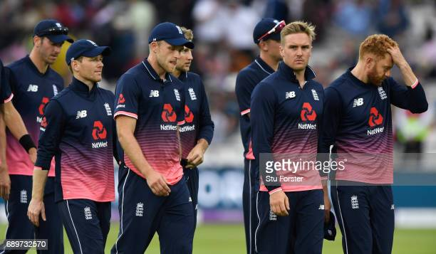 England captain Eoin Morgan leads his players off after a 7 wicket defeat after the 3rd Royal London Cup match between England and South Africa at...