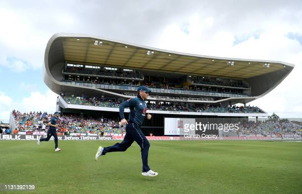 England captain Eoin Morgan leads his team on to the field ahead of the 2nd One Day International match between the West Indies and England at...