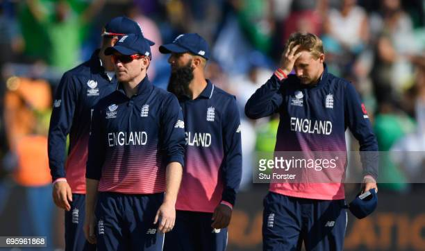 England captain Eoin Morgan leaves the field with his team after the ICC Champions Trophy semi final between England and Pakistan at SWALEC Stadium...