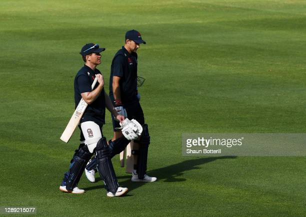 England captain Eoin Morgan leaves the field with team mate Joe Root during a Net Session at Newlands Cricket Ground on December 03, 2020 in Cape...