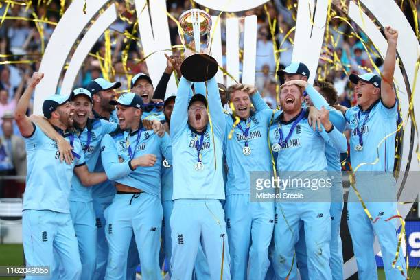England captain Eoin Morgan lifts the ICC World Cup trophy during the Final of the ICC Cricket World Cup 2019 between New Zealand and England at...
