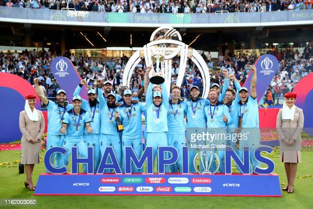 England Captain Eoin Morgan lifts the World Cup with the England team after victory for England during the Final of the ICC Cricket World Cup 2019...