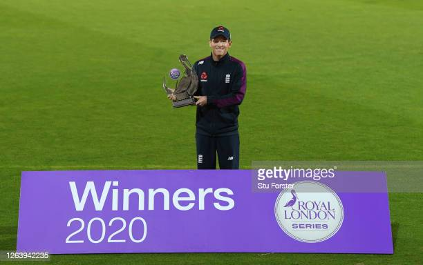 England captain Eoin Morgan poses with the Royal London Series Trophy after the Third One Day International between England and Ireland in the Royal...