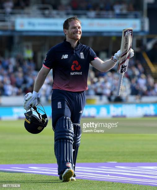 England captain Eoin Morgan salutes the crowd as he leaves the field after making 107 runs during the 1st Royal London ODI match between England and...