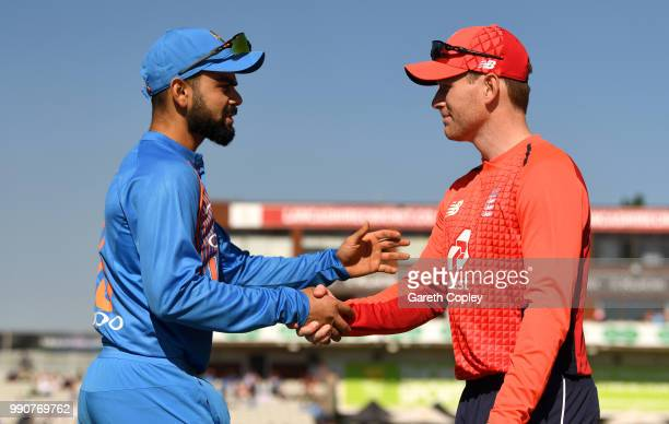 England captain Eoin Morgan shakes hand with India captain Virat Kohli ahead of the 1st Vitality International T20 match between England and India at...