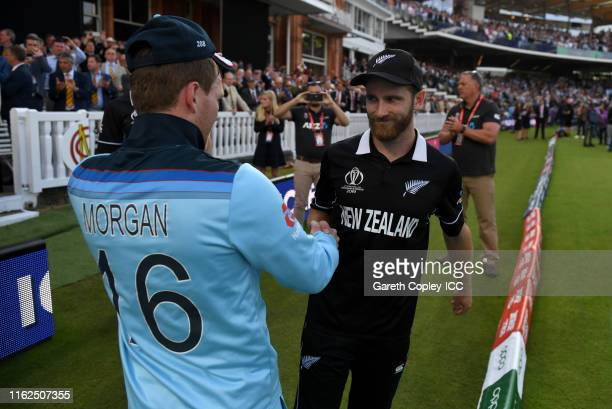 England captain Eoin Morgan shakes hands with New Zealand captain Kane Williamson after winning the Final of the ICC Cricket World Cup 2019 between...