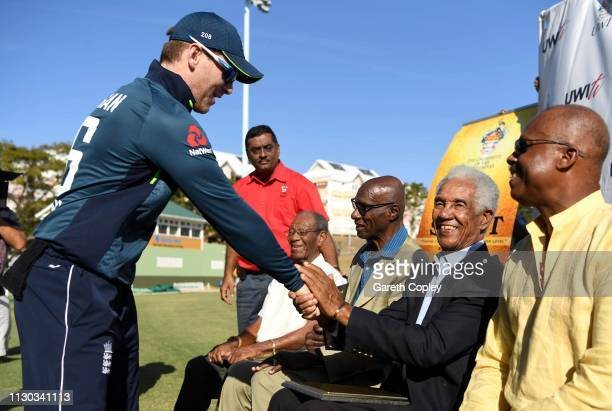 England captain Eoin Morgan shakes hands with Sir Garfield Sobers during a presentation in the interval of the One Day Tour Match between England and...