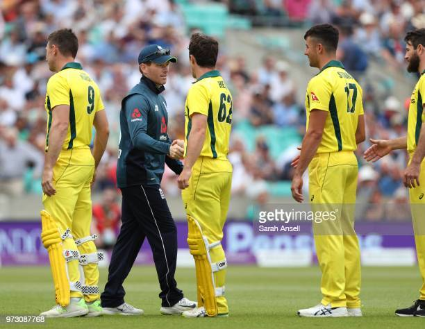 England captain Eoin Morgan shakes hands with Travis Head of Australia as the teams take part in the Fair Play Hand Shake before the start of the 1st...