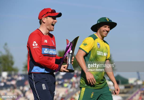 England captain Eoin Morgan shares a joke with South Africa captain AB de Villiers after posing with the trophy before the 1st NatWest T20...