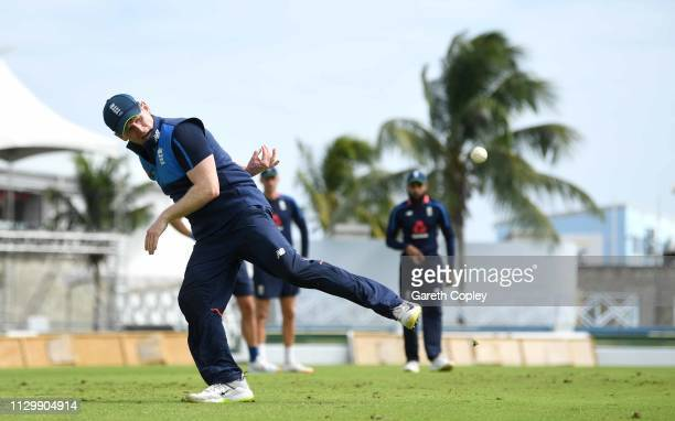 England captain Eoin Morgan throws the ball behind his back during a nets session at The Kensington Oval on February 15, 2019 in Bridgetown, Barbados.