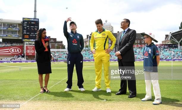 England captain Eoin Morgan tosses the coin alongside Australia captain Tim Paine ahead of the 1st Royal London ODI match between England and...