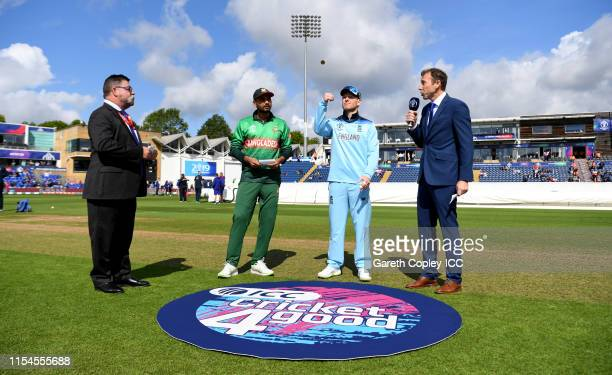 England captain Eoin Morgan tosses the coin alongside Bangladesh captain Mashrafe Mortaza ahead of the Group Stage match of the ICC Cricket World Cup...