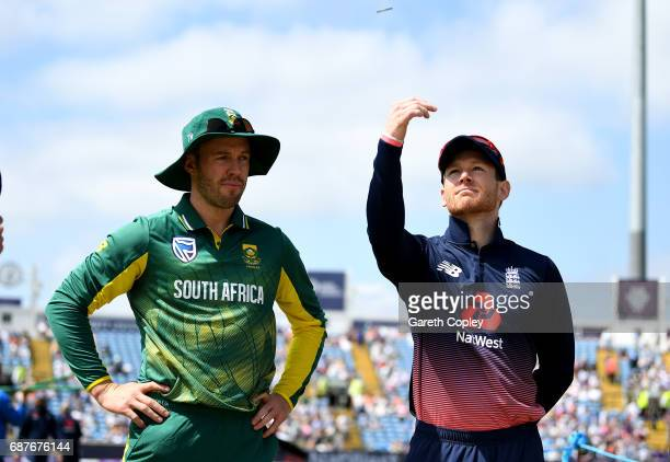 England captain Eoin Morgan tosses the coin alongside South Africa captain AB de Villiers the 1st Royal London ODI match between England and South...