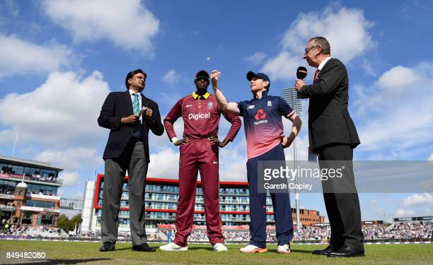 England captain Eoin Morgan tosses the coin alongside West Indies captain Jason Holder ahead of the 1st Royal London One Day International match...