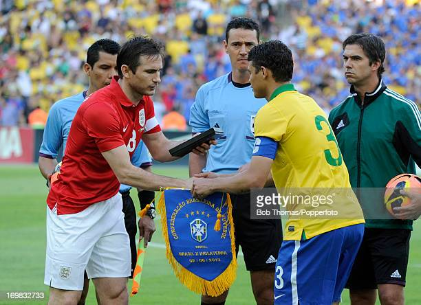 England captain Frank Lampard exchanges pennants with Brazilian captain Thiago Silva before the start of the International Friendly match between...