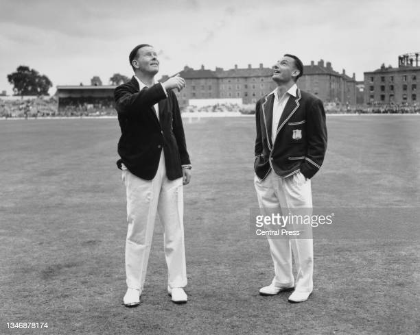 England captain Freddie Brown and John Goddard , captain of the touring West Indies cricket team toss a coin to decide who bats or fields first...