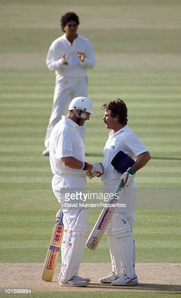 England captain Graham Gooch congratulates Allan Lamb on reaching his century on the first day of the 1st Test Match between England and India at...